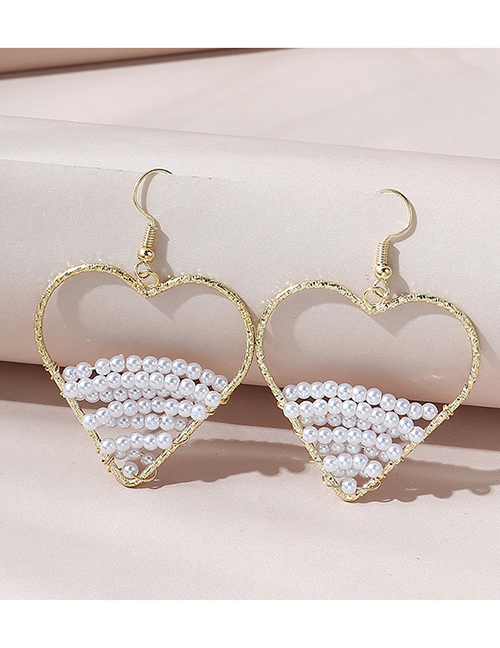 Fashion White Hollow Pearl Peach Heart Earrings