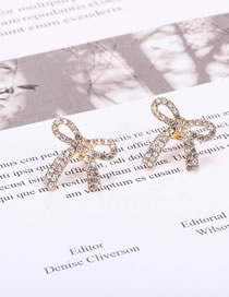 Fashion Golden Hollow Alloy Earrings With Diamond Bow
